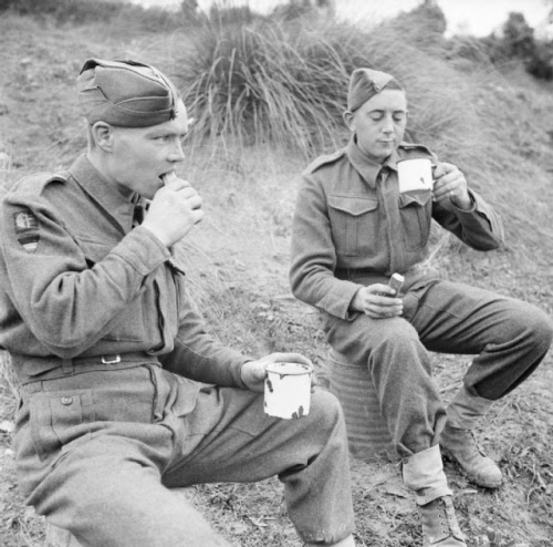 Soldiers from the 78th Division enjoying tea and cakes served by a Salvation Army van in the forward area, 28 November 1943