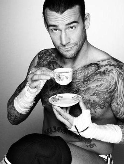 hot tattoo guy drinks tea