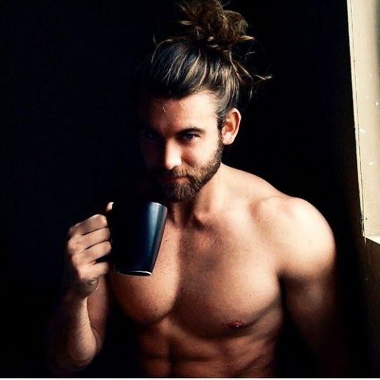 Sexy guy drinks tea
